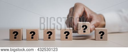 Hand Hold Wooden Cube Block In Question Mark Mean What On Cement Table Background, Column Of Wooden