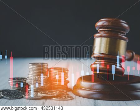 Old Wood Judge Hammer With Stacking Coins In Close-up And Coins Stack The Table Wood Background, Use