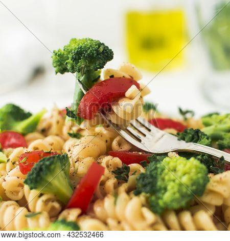 Close Up Fork With Broccoli Tomato Fusilli. High Quality Beautiful Photo Concept