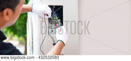 Technician Air-conditioning Repairman Using Measuring Equipment Checking Electric At Circuit Breaker