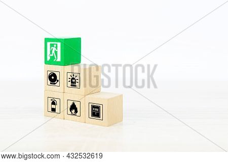 Fire Prevention, Close-up Cube Wooden Toy Block Stack With Door Exit Sing Or Fire Escape For Prevent