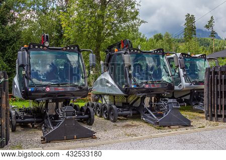Tatranska Lomnica, Slovakia - August 11, 2021: Snow Groomer Machines Abandoned In Summer At Ski Reso