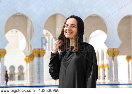 Beautiful Woman Is Wearing Arab Clothes In Sheikh Zayed Grand Mosque In Abu Dhabi, United Arab Emira