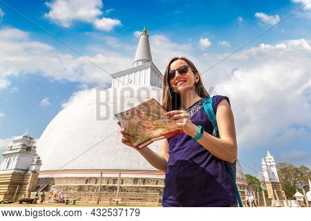 Woman Holding A Map Near Big White Ruwanwelisaya Stupa In Anuradhapura Archaeological Museum In Sri
