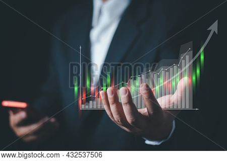 Businessman Or Trader Is Showing A Growing Virtual Hologram Stock. , Planning And Strategy, Stock Ma