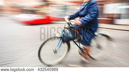 Abstract Image Of People In The Street With A Blurred Background. Intentional Motion Blur. Elderly W