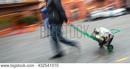 Abstract Image Of People In The Street With A Blurred Background. Intentional Motion Blur. Man Dragg