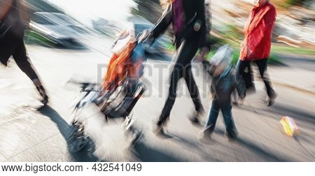 Abstract Image Of People In The Street With A Blurred Background. Intentional Motion Blur. Group Of