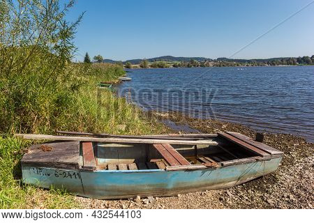 Lipno, Czech Republic - September 20, 2020: Little Old Rowing Boat On The Shore Of Lake Lipno, Czech