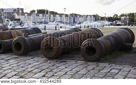 Old Rusty Canons By River At Promenade In Hellevoetlsuis