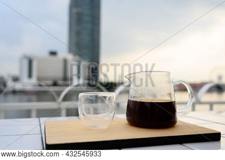 Drip Freshly Brewed Coffee In Glass Jar With A Cup On Wooden Tray. Hot Brew Coffee Drink Is Good For