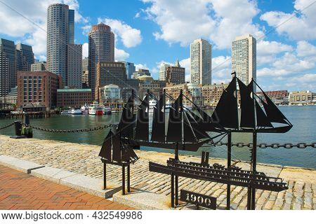 Boston, Usa - Sep. 5, 2018: Antique Ships Sculpture With Boston Rowes Wharf And Modern Financial Dis