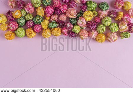 Colorful Rainbow Caramel Candy Popcorn On Pink Background. Cinema Snack Concept. Watching Movie And