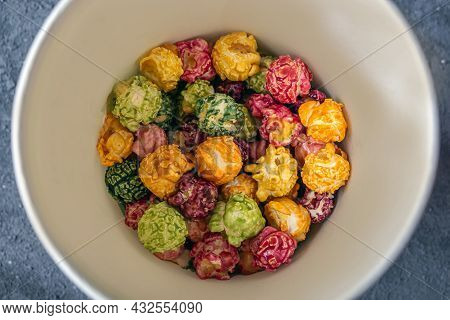 Colorful Rainbow Caramel Candy Popcorn On Dark Background. Cinema Snack Concept. Food For Watching M