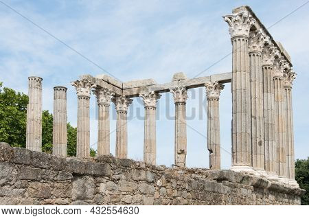 View Of Roman Temple At Evora, Portugal From Below. No People, Blue Sky. Europe