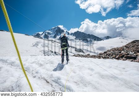 Young Female Back View Portrait Rope Team Member On Acclimatization Day Dressed Mountaineering Cloth
