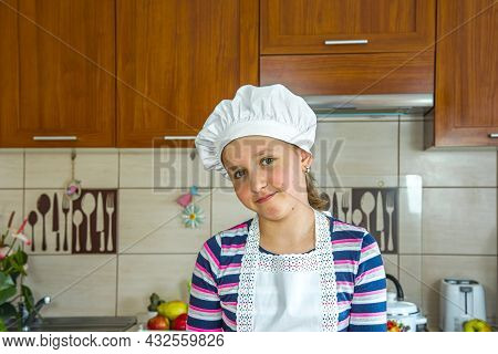 The Girl In The Cook's Hat. Cook Food At Home In The Kitchen
