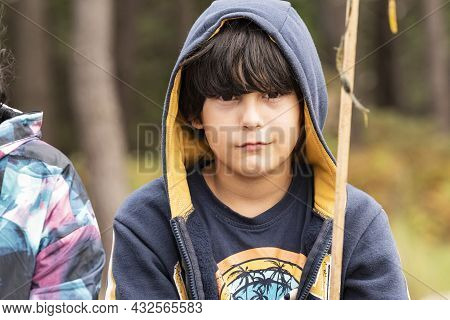Half-length Portrait Of A White Caucasian Boy With Brown Hair Wearing A Hooded Sweatshirt.
