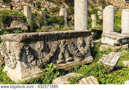Ancient Greek Ruins In Athens, Greece. Scenery Of Stone With Relief Carving In Roman Agora. Ornament
