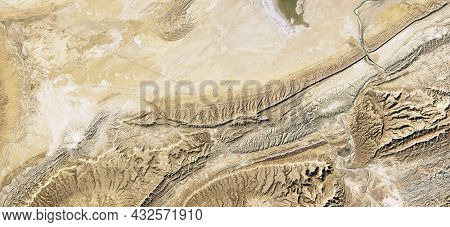 Desert Land On Satellite Photo, Topography. Aerial Top View Of Earth Surface As Abstract Background.