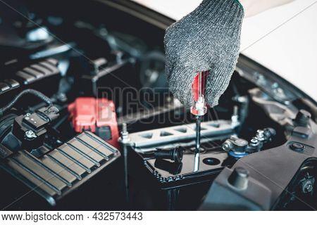 Close Up Hand A Man Wear Glove Use Screwdriver Open A Cap Battery For Add Distilled : Maintenance An