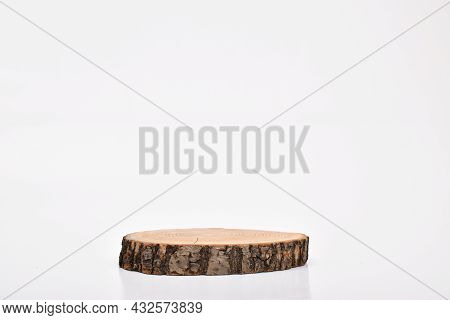 Wooden Stage On A White Background. A Podium For The Presentation Of Goods And Cosmetics. A Showcase
