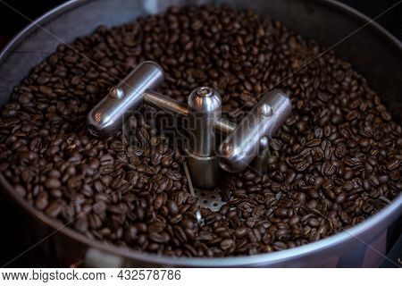 Fresh Coffee Beans Process At Roasting Plant. Industrial Electric Cooling Tray.