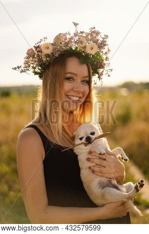 Human And A Dog. Girl And Her Friend Dog On The Field Background. Beautiful Young Woman Relaxed And