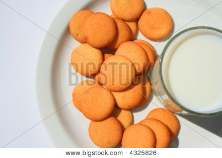 Close up of vanilla cookies and a glass of milk. poster