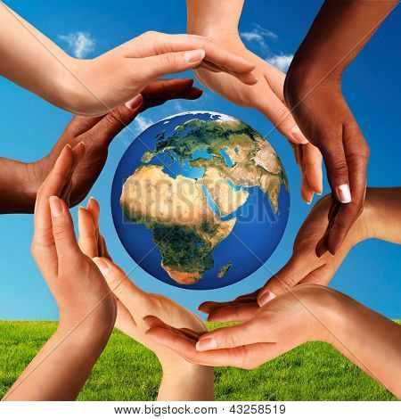Conceptual peace and cultural diversity symbol of multiracial hands making a circle together around the world the Earth globe on blue sky and green grass background. poster