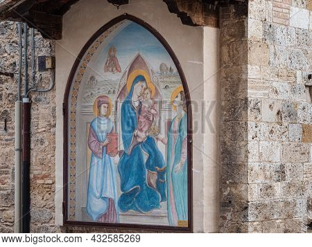 Religious Painting Depicting The Madonna With Baby Jesus In Her Arms On The External Wall Of A Publi