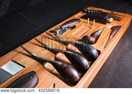 Exclusive Handmade Leather Craft Tools. Close Up Of Different Tanner Tools On Wooden Box. Set Of Dif