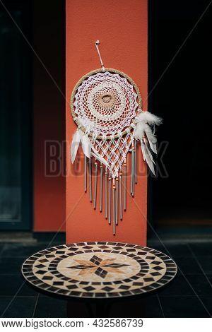 Beautiful Dreamcatcher Hanging On Wall Over Rag Outside. Crochet Weave, Handmade Work. Decor And Amu