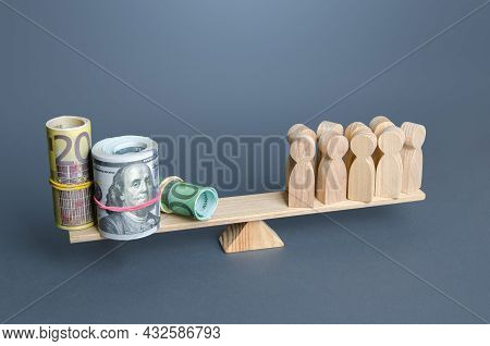 People And Money On The Scales. Concept Of Wages For Employees And Workers. Financial Support And Ch