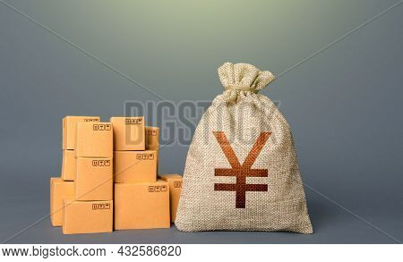Boxes And Chinese Yen Or Japanese Yuan Money Bag. The Concept Of Trade In Goods And Production. Prof
