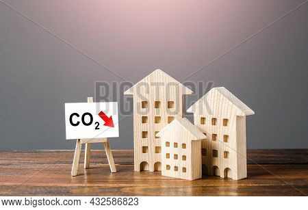 Green House And Easel With Carbon Dioxide Reduction. Environmentally Friendly. Improving Utilities A