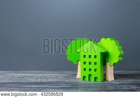Green Eco House With Trees. Autonomy And Natural Resources Economy. Energy Saving Housing Technologi