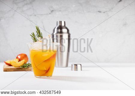 Cooking Of Homemade Vitamin Summer Fresh Orange Peach Lemonade With Ice, Green Rosemary Twig, Sugar