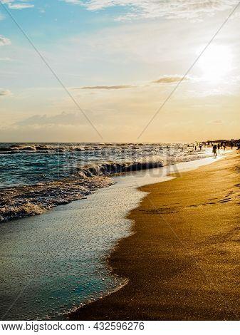 Beautiful Seascape: Sunset Over A Sandy Beach
