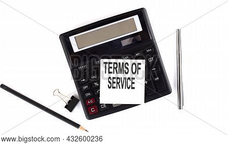 Terms Of Service Text On Sticker On Calculator With Pen,pencil On White Background