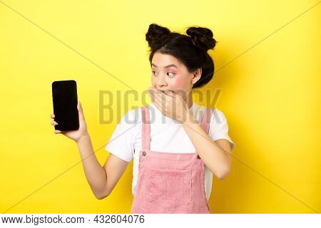 Online Shopping Concept. Silly Japanese Girl With Beauty Makeup, Cover Mouth With Hand Laughing And