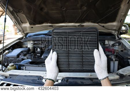Manual Car Air Filter Replacement To Maintain Engine Performance.air Filter Is Clogged. Causing Inco