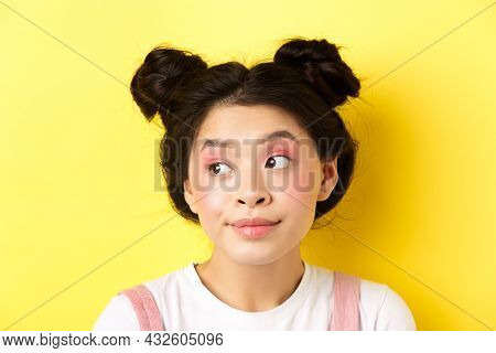 Close-up Portrait Of Cute Glamour Asian Girl, Bright Makeup And Hairstyle, Looking Aside At Logo Wit