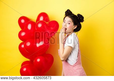 Valentines Day And Relationship Concept. Coquettish And Romantic Girl Laughing, Covering Mouth With