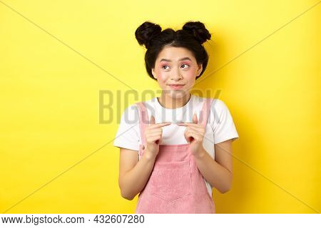 Summer Lifestyle Concept. Cute Shy Asian Girl Looking Away And Smiling Silly, Avoiding Eye Contact,