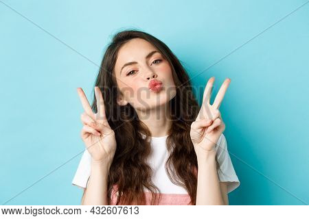 Close Up Portrait Of Glamour Brunette Girl Making Kissing Face, Showing Kawaii V-sign And Smiling Cu