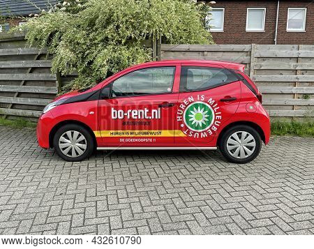 Almere, The Netherland - August 20, 2021: Red Bo-rent Rental Car Parked By The Side Of The Road.