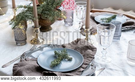 Festive Table Setting For Christmas. Christmas Decor For Cafe, Restaurant, Dining Room. Spruce Twigs