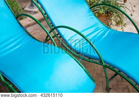 Close Up Of Two Poolside Loungers With Beautiful Colors - Poolside Furniture - Leisure Activity - Ho