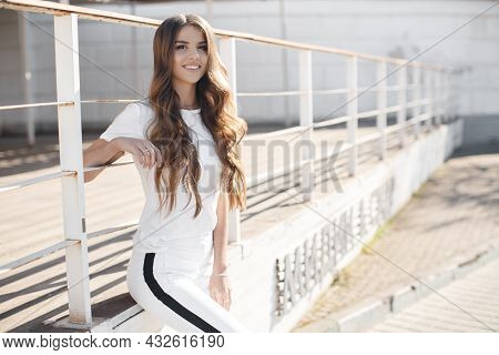 A Young Beautiful Woman With Long, Hair And Brown Eyes, Beautiful Makeup, Pink Plump Lips, Sweet Smi